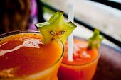 image of fruit-juice  - A couple of glasses of Maracuya, passion fruit, juice