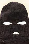 pic of shoplifting  - Isolated black Ski mask on white backround - JPG