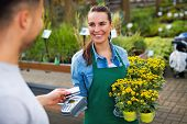 Paying with credit card at garden center   poster