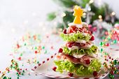 Christmas tree from toasted bread, lettuce, ham and cheese. Festive idea for Christmas or New Year d poster