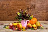 Постер, плакат: Thanksgiving Centerpiece With Wild Flowers In Pink Pitcher Vase