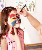 foto of face painting  - Child preschooler with face painting - JPG