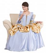 stock photo of marquise  - Girl in old long blue dress on armchair - JPG