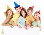image of young adult  - Group of young people in party hat holding banner - JPG