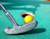 picture of miniature golf  - Golf stick and ball on green grass close up - JPG