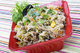 pic of pancit  - Pancit in a Red Ceramic Dish on a colorful background - JPG