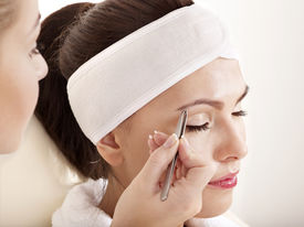 picture of eyebrows  - Tweezing eyebrow by beautician - JPG