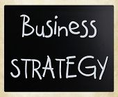 "image of self assessment  - ""Business strategy"" handwritten with white chalk on a blackboard - JPG"