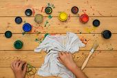 The Girl Rolls Up A White T-shirt For Painting In The Style Of Tie Dye. Staining Fabric In Tie Dye S poster
