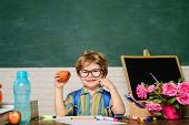 Schoolboy Have Lunch During Break Time. Cute Kid Eating In School. Pupil Enjoy Healthy Lunch. Boy At poster