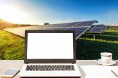 Mockup Image Of Laptop With Blank Blank Screen,smartphone,coffee Cup On Wooden Table Of Solar Panel  poster