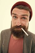 Hipster Brutal Bearded Tobacco Smoker. Man Brutal Bearded Hipster Dressed As Vagabond Smoking Cigare poster