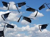 picture of graduation hat  - Graduation hats being tossed into the sky - JPG