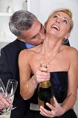 image of aroused  - Man kissing his wife - JPG