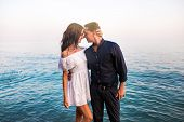 Young Romantic Couple Is About Kiss At Sunset. Romantic And Honeymoons Concept. poster
