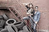 Sexy And Fashionable Couple Wearing Jeans, Shoot In A Grungy Location - Landscape Orientation With C