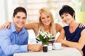 image of laws-of-attraction  - happy young man with wife and mother - JPG