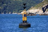 stock photo of dartmouth  - channel marker buoy at Dartmouth entrance, Devon