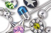 foto of piercings  - Many Jewelry For Piercing Isolated On White Background - JPG