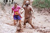 MUSKOGEE, OK - SEPT. 14 : Actors portraying zombies wait for runners to cross their mud pit  during