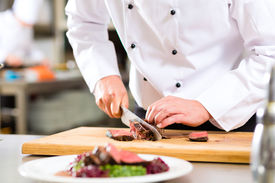 picture of adults only  - Chef in hotel or restaurant kitchen cooking - JPG