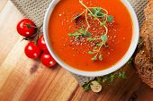 stock photo of gourmet food  - Fresh gourmet tomato soup with fresh herbs and pepper - JPG