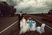 Bride and groom at wedding table on the countryside road