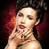 picture of minx  - Beautiful woman with golded nails and bright red lips - JPG