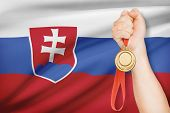 Medal In Hand With Flag On Background - Slovak Republic