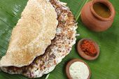 stock photo of carbohydrate  - Onion Dosa is a typical South Indian food rich in carbohydrates and proteins - JPG