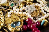 pic of precious stone  - Closeup of gold jewelery with precious stones - JPG