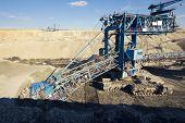 image of dredge  - a huge working dredge in a mine - JPG