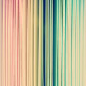 foto of end rainbow  - Rainbow color spectrum of thick paper ends from red to purple - JPG