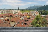 image of annecy  - Annecy cityscape with red roof of traditional houses under sky in France - JPG