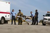 picture of stretcher  - Paramedics transporting victim on stretcher - JPG