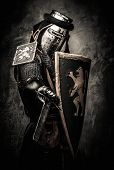 stock photo of knights  - Medieval knight with a sword against stone wall - JPG