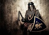 image of knights  - Medieval knight on golden wall background - JPG