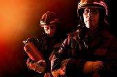 stock photo of fireman  - Dramatic image of firemen team in uniform - JPG