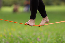 pic of anchor  - Lady practising slack line in the city park - JPG