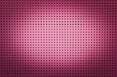 stock photo of metal grate  - Pink metal hole sheet texture closeup background - JPG