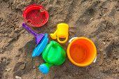 picture of children beach  - Plastic children toys on the sand beach - JPG