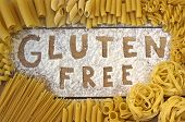 picture of flaxseeds  - a gluten free word with wood background - JPG