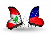 stock photo of samoa  - Two butterflies with flags on wings as symbol of relations Lebanon and Samoa - JPG