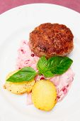 pic of patty-cake  - Beef patty cake with creamy sauce and potatoes on plate - JPG