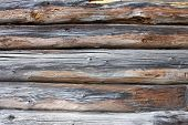 picture of log fence  - piece of a wall in a old house made of logs - JPG
