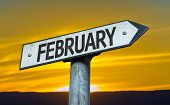 stock photo of february  - February sign with a sunset background - JPG