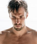 pic of goatee  - Serious shirtless attractive young man with a goatee staring thoughtfully at the ground - JPG