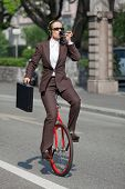 picture of unicycle  - woman through the city with the unicycle to go to work - JPG