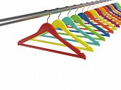 foto of clothes hanger  - 3d render of colorful clothes hangers isolated on white background - JPG