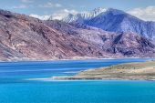 foto of jammu kashmir  - Mountains and Pangong tso (Lake). It is huge lake in Ladakh altitude 4350 m (14270 ft). It is 134 km (83 mi) long and extends from India to Tibet. Leh Ladakh Jammu and Kashmir India